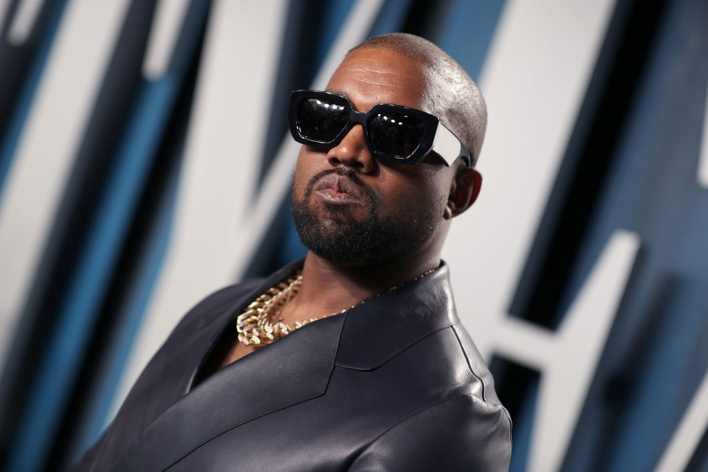 Kanye West posing with sun glasses