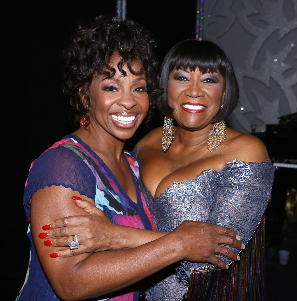 Patti LaBelle and Gladys Knight hugging