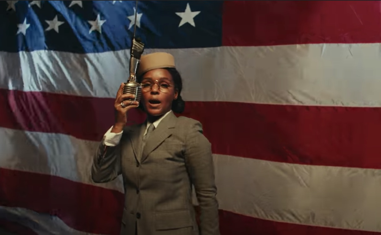 Janelle Monáe in front of american flag