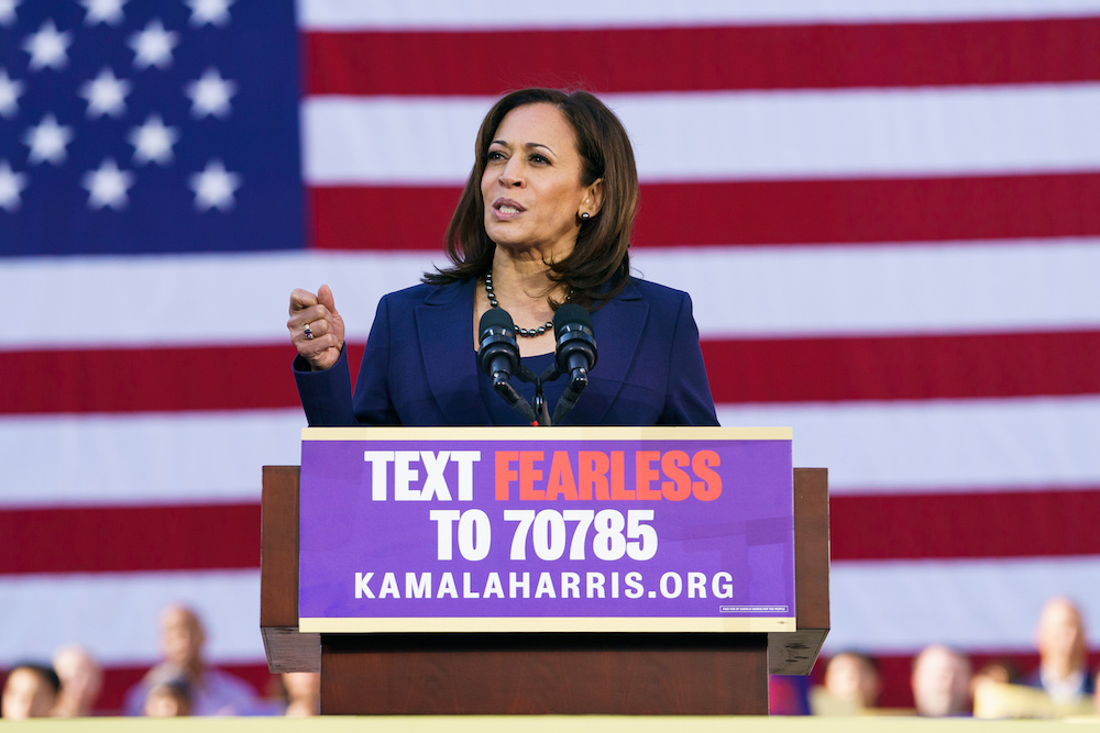 Kamala Harris giving speech in front of american flag