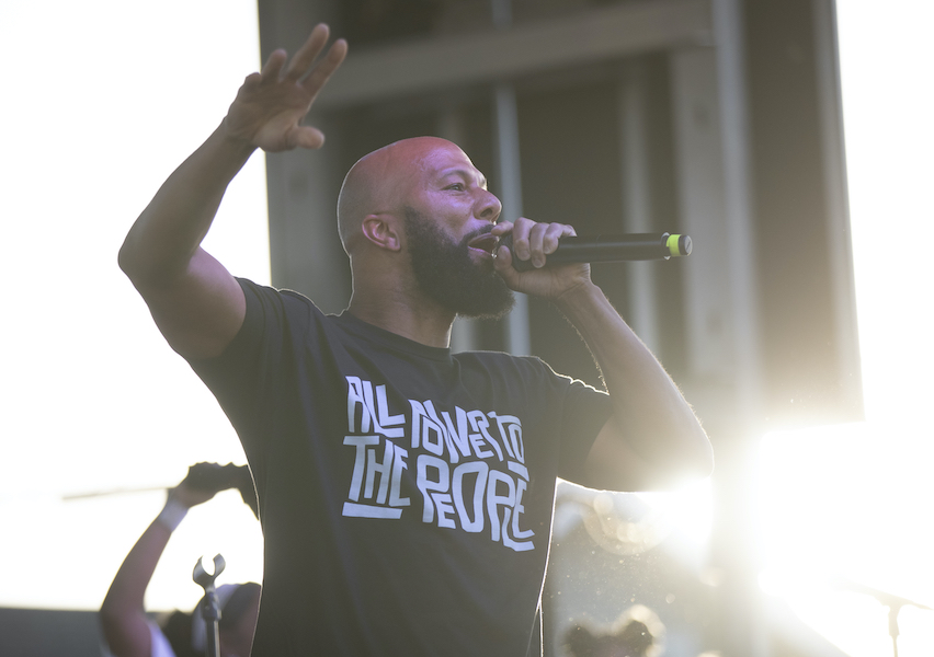 Common performs on stage with The Sounds of Blackness during the 1 year anniversary of the death of George Floyd
